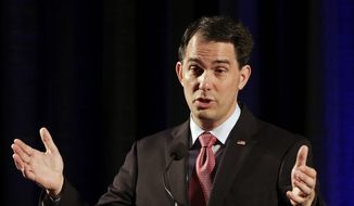 Wisconsin Gov. Scott Walker speaks during the North Carolina Republican Party convention in Raleigh, N.C., Friday, June 5, 2015. (AP Photo/Gerry Broome) ** FILE **
