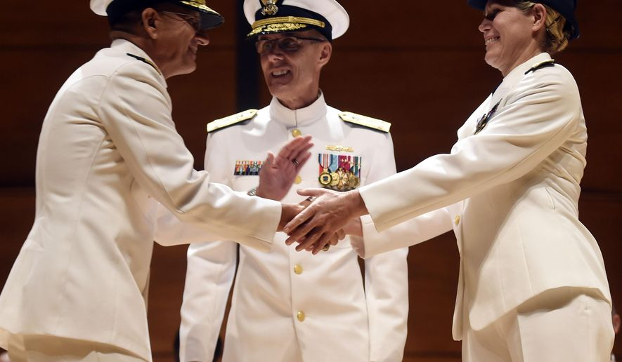 Incoming U.S. Coast Guard Academy superintendent Rear Adm. James E. Rendon, left, shakes hands with his predecessor; newly promoted U.S. Coast Guard Vice Admiral Sandra L. Stosz, right, as presiding officer Vice Adm. Peter Neffenger, center, offers he congratulations during a change of command ceremony, Monday, June 1, 2015 in Leamy Hall Auditorium. Stosz will move to Coast Guard headquarters as Deputy Commandant for Mission Support. (Sean D. Elliot/The Day via AP)