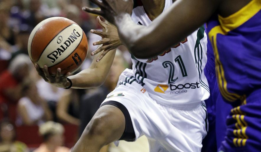 Seattle Storms' Renee Montgomery (21) drives past Los Angeles Sparks defenders in the first half of a WNBA basketball game Saturday, June 6, 2015, in Seattle. (AP Photo/Elaine Thompson)