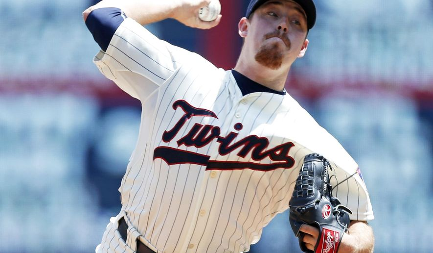 Minnesota Twins pitcher J.R. Graham throws against the Milwaukee Brewers in the first inning of a baseball game, Saturday, June 6, 2015, in Minneapolis. (AP Photo/Jim Mone)