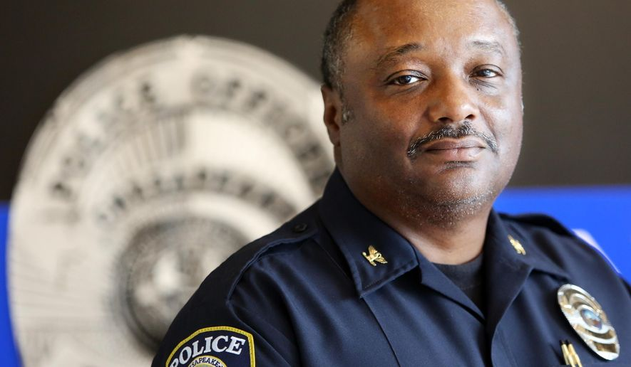 Colonel Kelvin L. Wright, chief of the Chesapeake Police Department, is photographed police headquarters building on Friday, May 29, 2015 in Chesapeake, Va.   Chesapeake officers are equipped with 256 Taser Axon cameras, with 14 more coming in June when a new batch of police academy graduates joins the department.   (Steve Earley/The Virginian-Pilot via AP)  MAGS OUT