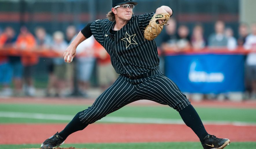 Vanderbilt pitcher Carson Fulmer (15) throws against Illinois during the first inning of an NCAA college baseball tournament super regional game, Saturday, June 6, 2015, in Champaign, Ill. (AP Photo/Bradley Leeb)