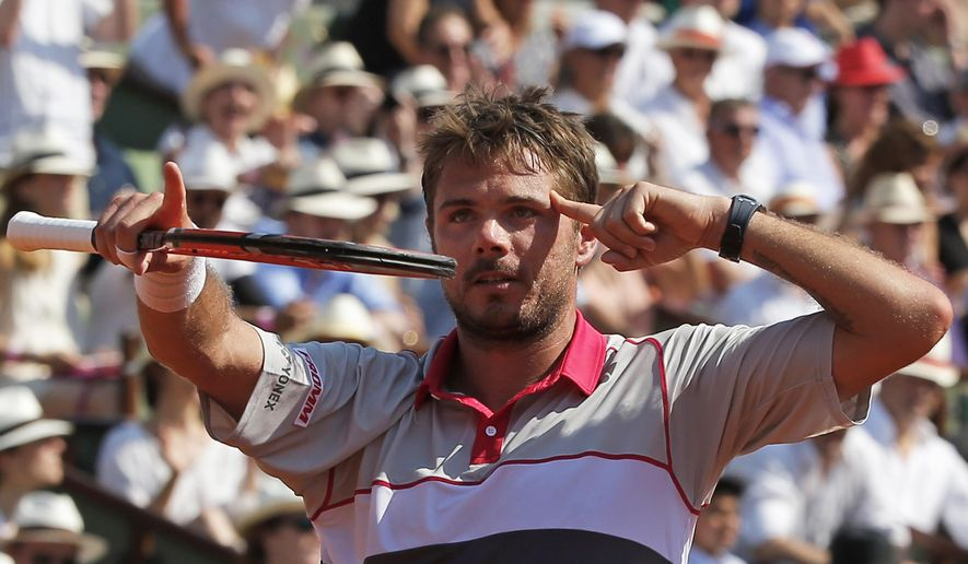 Switzerland's Stan Wawrinka celebrates winning the semifinal match of the French Open tennis tournament against France's Jo-Wilfried Tsonga in four sets 6-3, 6-7, 7-6, 6-4, at the Roland Garros stadium, in Paris, France, Friday, June 5, 2015. (AP Photo/Michel Euler)