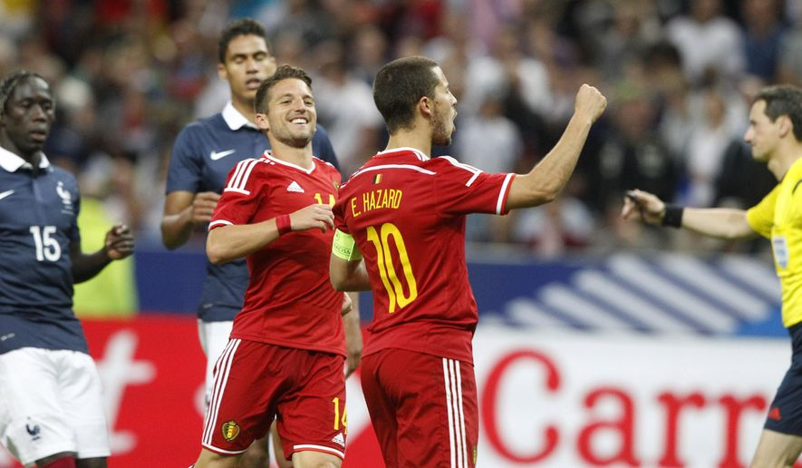 Belgium's Eden Hazard, right, reacts after scoring the fourth goal during the international friendly soccer match between France and Belgium at the Stade de France, north of Paris, France, Sunday, June 7, 2015. (AP Photo/Michel Spingler)