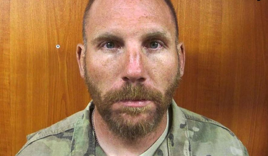 "This U.S. Army photo, provided by the Tacoma, Wash., News-Tribune, shows Staff Sergeant Robert Bales in March, 2012. The Army's caption describes it as being taken the night of the attacks. Bales, who murdered 16 Afghan villagers in 2012, says he had lost compassion for Iraqis and Afghans over the course of his four combat deployments. The News Tribune newspaper obtained an eight-page letter Bales wrote to the senior Army officer at Joint Base Lewis-McChord, Wash., requesting that his life sentence be reduced. He said his mind was ""consumed by war,"" and that after being in prison at Fort Leavenworth, Kan, for two years he now understands that what he thought was normal was the farthest thing from it.(U.S. Army/Tacoma News-Tribune via AP)"