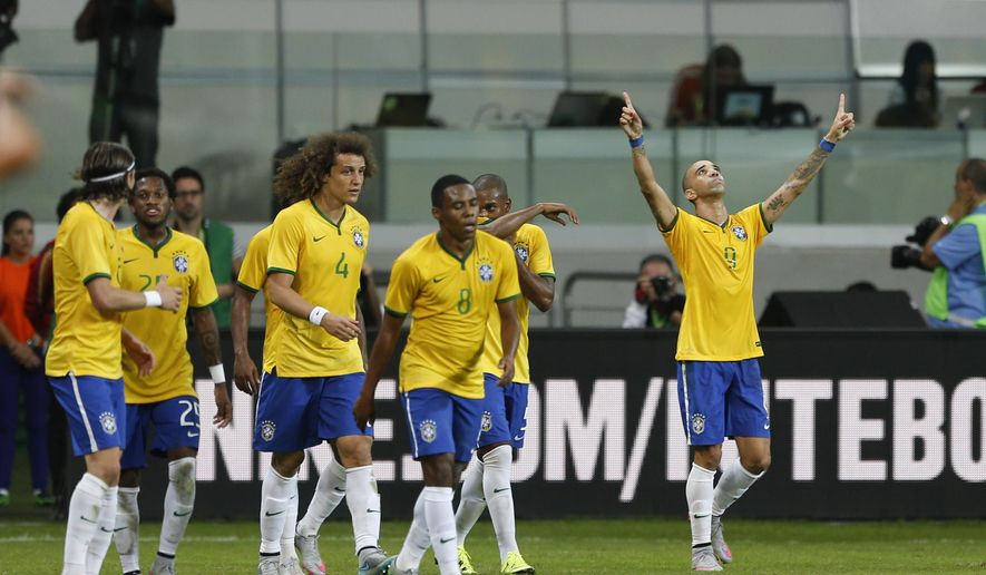 Brazil's Diego Tardelli, right, celebrates after scoring against Mexico during a friendly soccer match in Sao Paulo, Brazil, Sunday, June 7, 2015. Brazil and Mexico are preparing for the Copa America which begins Thursday in Chile. (AP Photo/Andre Penner)