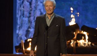 Clint Eastwood speaks at the 2015 Spike TV Guy's Choice Awards at Sony Studios on Saturday, June 6, 2015, at Sony Studios in Culver City, Calif.  (Photo by Phil McCarten/Invision/AP)