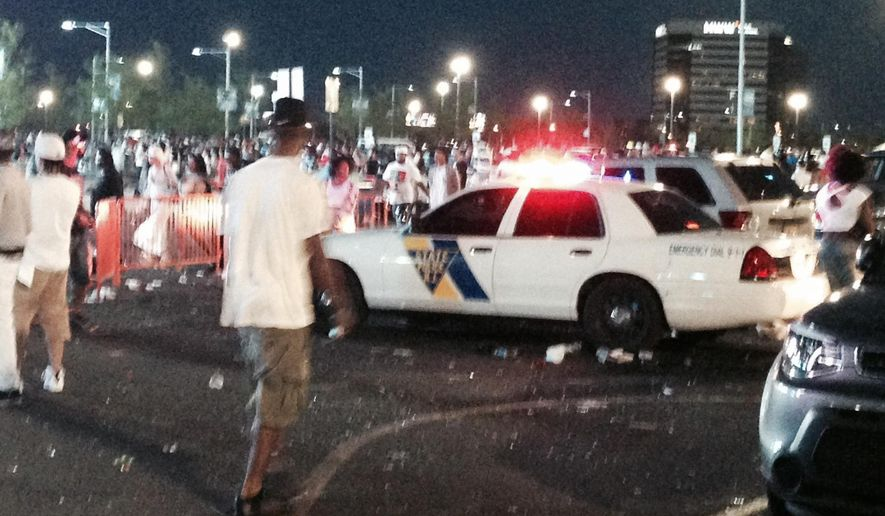 Fans at the Hot 97 Summer Jam concert confront police officers outside the MetLife Stadium in East Rutherford, N.J., on Sunday. (Associated Press)
