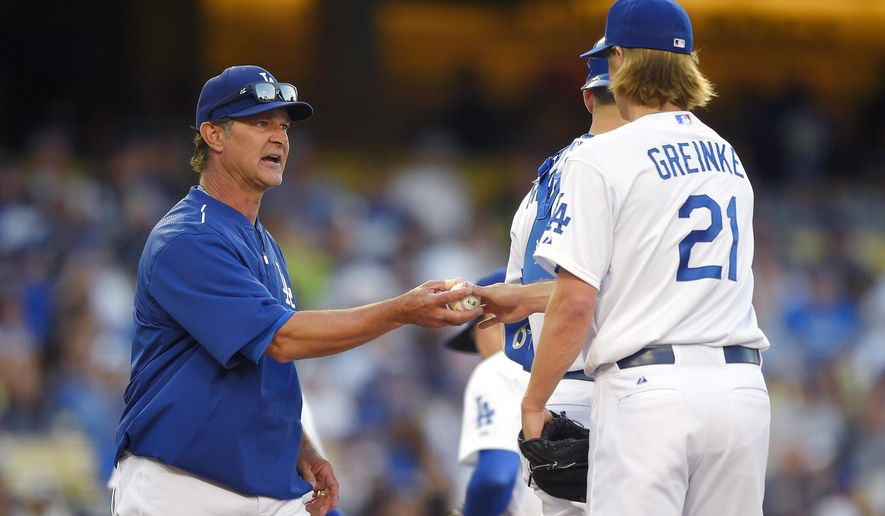 Los Angeles Dodgers starting pitcher Zack Greinke, right, is taken out of the game by manager Don Mattingly during the seventh inning of a baseball game against the St. Louis Cardinals, Sunday, June 7, 2015, in Los Angeles. (AP Photo/Mark J. Terrill)