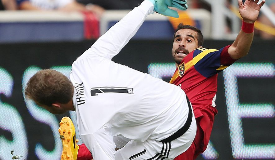 Real Salt Lake forward Sebastian Jaime (23) has his shot blocked by Colorado Rapids goalkeeper Clint Irwin (1) during MLS action in Sandy  Sunday, June 7, 2015.  (Jeffrey D. Allred/The Deseret News via AP)  MANDATORY CREDIT; SALT LAKE TRIBUNE OUT;  MAGS OUT