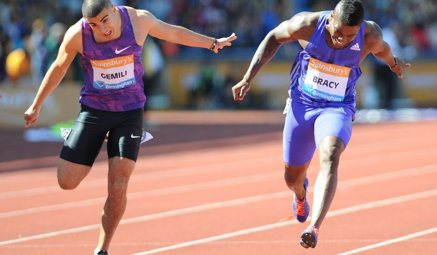 USA's Marvin Bracy, right, wins the Men's 100M Final ahead of second place Great Britain's Adam Gemili at the Birmingham Grand Prix Diamond League Athletics meeting, at Alexander stadium in Birmingham, England, Sunday, June 7, 2015. (AP Photo/Rui Vieira)