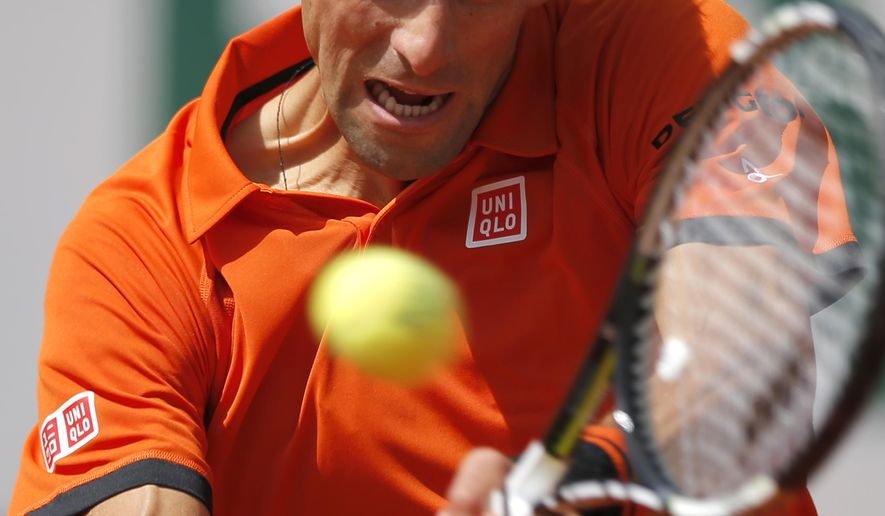 Serbia's Novak Djokovic returns the ball  to Switzerland's Stan Wawrinka during their final match of the French Open tennis tournament at the Roland Garros stadium, Sunday, June 7, 2015 in Paris.  (AP Photo/Francois Mori)