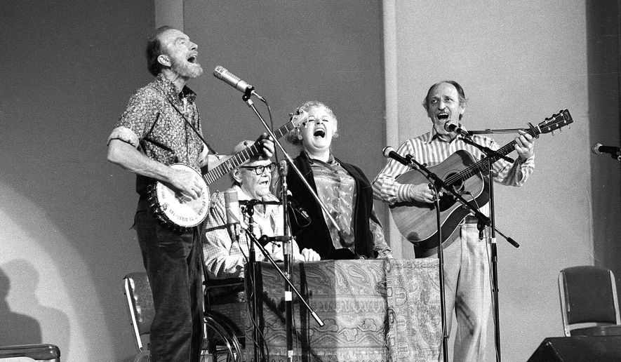 CORRECTS THE FIRST NAME OF  GILBERT'S PARTNER TO DONNA - FILE - In this Nov. 28, 1980, file photo, The Weavers perform in a 25th Anniversary reunion concert at Carnegie Hall in New York. From left are: Pete Seeger, Lee Hays, Ronnie Gilbert and Fred Hellerman. Ronnie Gilbert has died. She was 88. Her longtime partner, Donna Korones, says Gilbert died of natural causes Saturday, June 6, 2015, at a retirement community in Mill Valley, Calif. (AP Photo/Richard Drew, File)