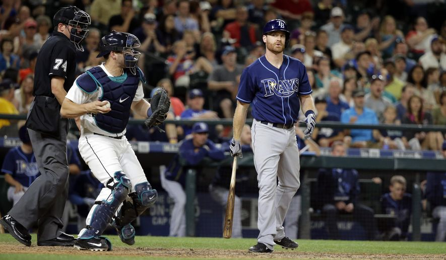Tampa Bay Rays' Logan Forsythe, right, reacts to being called out on strikes as Seattle Mariners catcher Mike Zunino returns the ball in the ninth inning of a baseball game, Saturday, June 6, 2015, in Seattle. The Mariners beat the Rays 2-1. (AP Photo/Ted S. Warren)