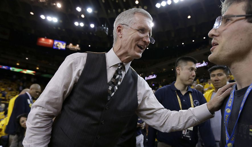In this June 4, 2015,  photo, Mike Breen, NBA play-by-play sports commentator for ABC, greets fans before Game 1 of basketball's NBA Finals between the Golden State Warriors and Cleveland Cavaliers in Oakland, Calif. Breen is calling his 10th NBA Finals, a record for a TV play-by-play announcer. (AP Photo/Ben Margot)