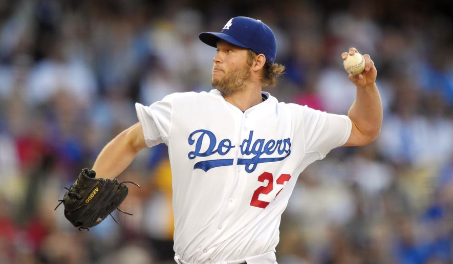 Los Angeles Dodgers starting pitcher Clayton Kershaw throws to the plate during the second inning of a baseball game against the St. Louis Cardinals, Saturday, June 6, 2015, in Los Angeles. (AP Photo/Mark J. Terrill)