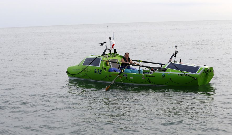 American rower Sonya Baumstein, from Orlando, Fla., rows a boat as she leaves Choshi Marina in Choshi, a port east of Tokyo, headed for San Francisco Sunday, June 7, 2015. Baumstein hopes to finish the 6,000-mile (9,600-kilometer) journey by late September and become the first woman to row solo across the Pacific in the 23-foot (7-meter) -long vessel. (AP Photo/Shizuo Kambayashi)