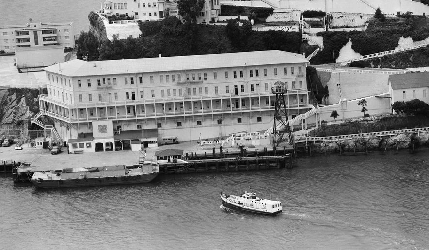FILE - In this June 12, 1962, file photo, Alcatraz Federal Penitentiary in San Francisco Bay is shown the day three prisoners escaped. The men crawled through holes they'd cut in their cell walls, climbed to the roof and left on a raft fashioned from prison raincoats and rubber cement. They were never found; officials surmised they may have drowned before reaching shore.  (AP Photo/File)