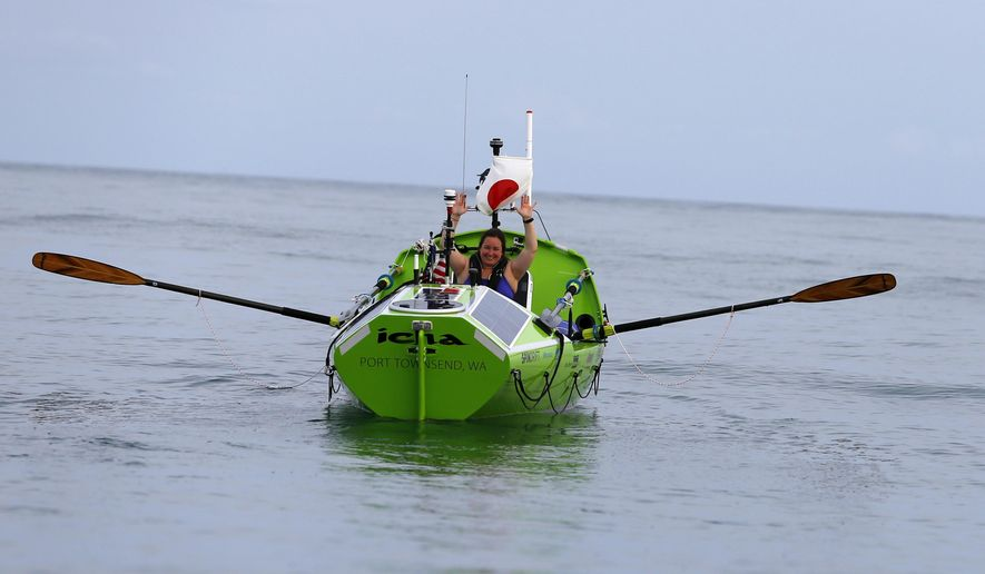 American rower Sonya Baumstein, from Orlando, Fla., waves as she leaves Choshi Marina in Choshi, a port east of Tokyo, headed for San Francisco Sunday, June 7, 2015. Baumstein hopes to finish the 6,000-mile (9,600-kilometer) journey by late September and become the first woman to row solo across the Pacific in the 23-foot (7-meter) -long vessel. (AP Photo/Shizuo Kambayashi)