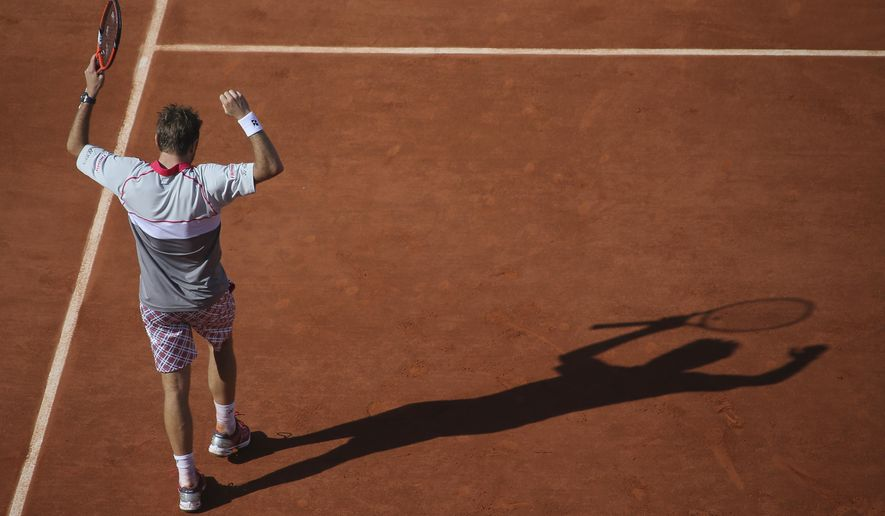 Switzerland's Stan Wawrinka celebrates scoring a point in the men's final of the French Open tennis tournament against Serbia's Novak Djokovic at the Roland Garros stadium, in Paris, France, Sunday, June 7, 2015. (AP Photo/David Vincent)