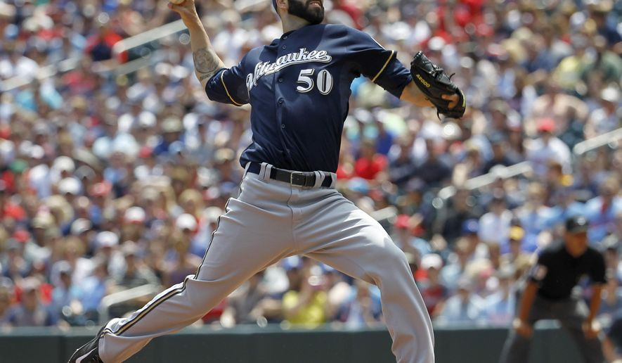 Milwaukee Brewers starting pitcher Mike Fiers (50) delivers to the Minnesota Twins during the first inning of a baseball game in Minneapolis, Sunday, June 7, 2015. The Twins won 2-0. (AP Photo/Ann Heisenfelt)