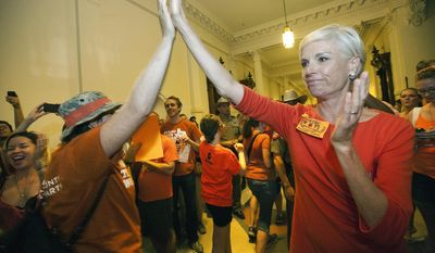 Cecile Richards, daughter of former Texas Gov. Ann Richards and president of the Planned Parenthood Federation of America, greets abortion rights advocates as they leave the State Capitol rotunda in Austin, Texas, on July 12, 2013. (Associated Press) **FILE**