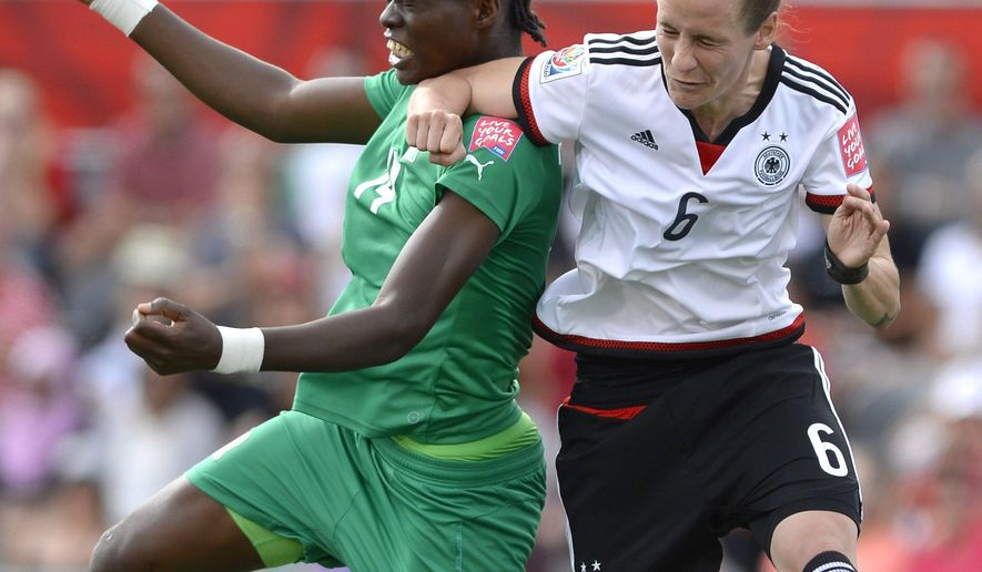 Germany's Simone Laudehr (6) battles for the ball with Ivory Coast's Josee Nahi (14) during first half FIFA Women's World Cup soccer action in Ottawa, Ontario on Sunday, June 7, 2015. (Justin Tang/The Canadian Press via AP) MANDATORY CREDIT