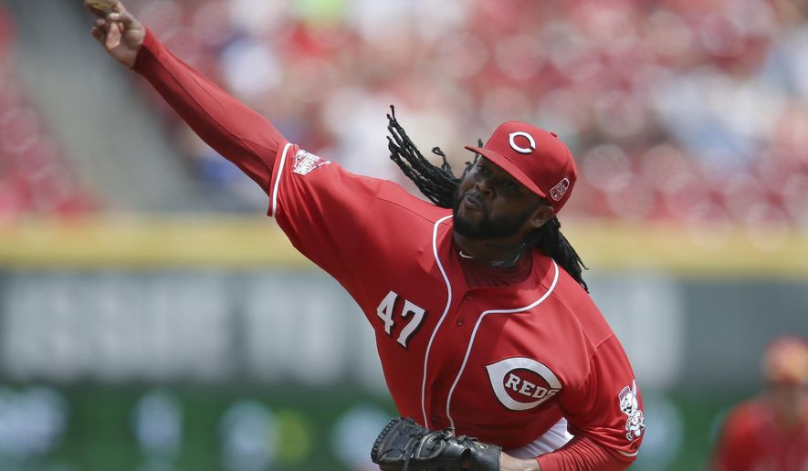 Cincinnati Reds starting pitcher Johnny Cueto throws in the fourth inning of a baseball game against the San Diego Padres, Sunday, June 7, 2015, in Cincinnati. (AP Photo/John Minchillo)