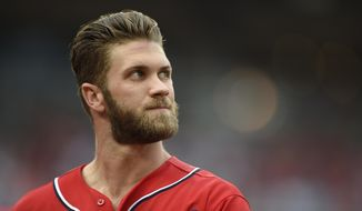 Washington Nationals' Bryce Harper walks back to the dugout after he flew out during the fifth inning of a baseball game against the Chicago Cubs, Sunday, June 7, 2015, in Washington. (AP Photo/Nick Wass)