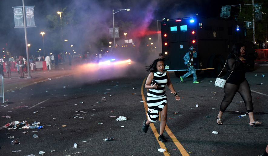 State Police respond to disturbances outside the MetLife Stadium where Summer Jam Hot 97 concert was held in East Rutherford, N.J., Sunday, June 7, 2015. Crowds on Sunday night became upset when the gates were closed and blocked off by police in riot gear, the Asbury Park Press reported. (Tyson Trish/The Record of Bergen County via AP) ONLINE OUT; MAGS OUT; TV OUT; INTERNET OUT;  NO ARCHIVING; MANDATORY CREDIT