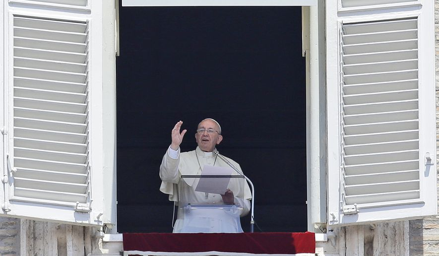 Pope Francis delivers a blessing during the Angelus prayer in St. Peter's Square, at the Vatican, Sunday, June 7, 2015. (AP Photo/Gregorio Borgia)