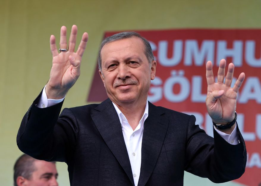 Recep Tayyip Erdogan, who has dominated the political scene for more than a dozen years, campaigned on behalf of his former party, the Islamist-rooted Peace and Development Party (AKP), appealing to voters to elect at least 300 parliamentarians to help push through a constitution that would expand his powers as an executive.  (Associated Press)