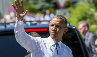 U.S. President Barack Obama waves as he arrives in the village of Kruen, southern Germany, Sunday, June 7, 2015 prior to the G-7 summit in Schloss Elmau hotel near Garmisch-Partenkirchen. (Marc Mueller/Pool Photo via AP)