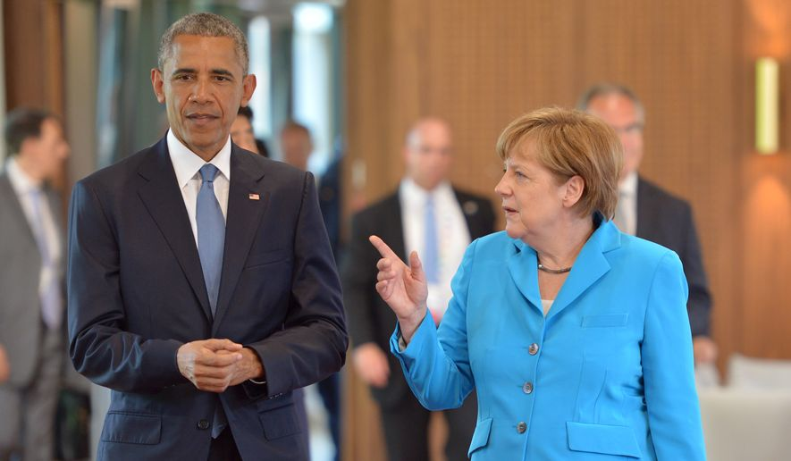 German Chancellor Angela Merkel, right, talks to U.S. President Barack Obama as they arrive for the first plenary session of the G-7 summit in Schloss Elmau hotel near Garmisch-Partenkirchen, southern Germany, Sunday, June 7, 2015. (Peter Kneffel/Pool Photo via AP)