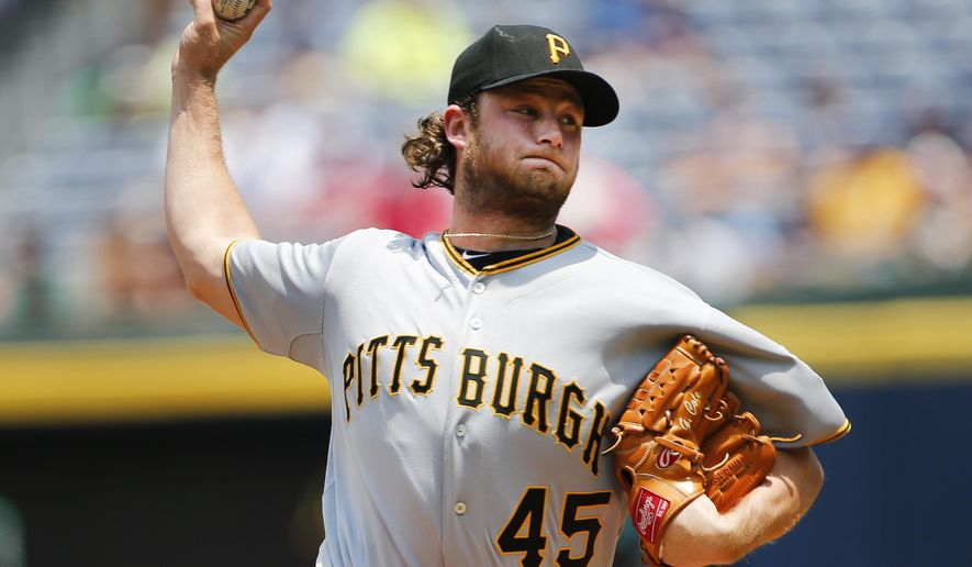 Pittsburgh Pirates starting pitcher Gerrit Cole (45) works in the first inning of a baseball game against the Atlanta Braves, Sunday, June 7, 2015, in Atlanta. (AP Photo/John Bazemore)