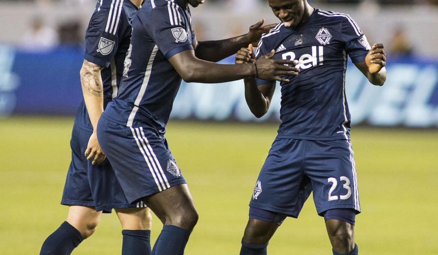 Vancouver Whitecaps forward Kekuta Manneh, right, celebrates with his team after scoring his goal against the Los Angeles Galaxy in the first half of an MLS soccer game at StubHub Center in Carson, Calif., Saturday, June 6, 2015. (AP Photo/Ringo H.W. Chiu)