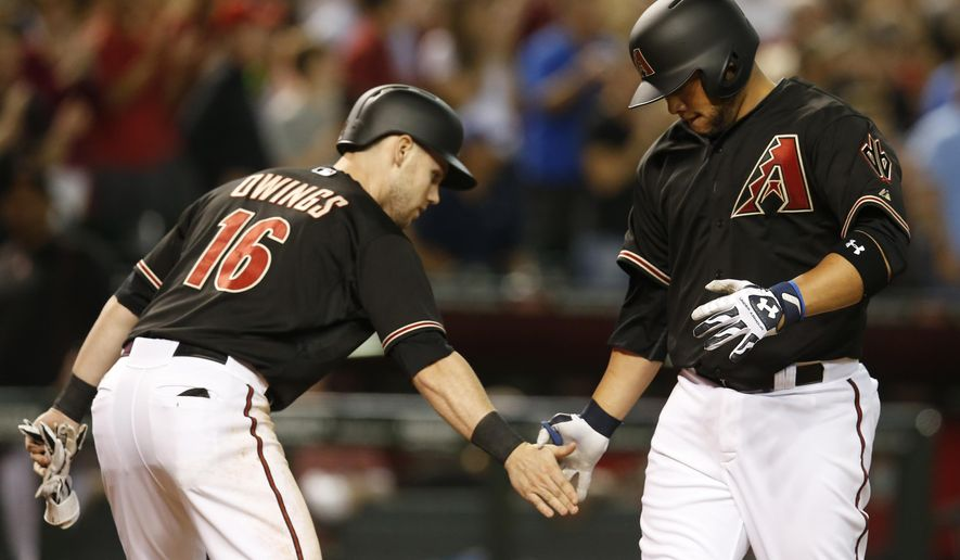 Arizona Diamondbacks Welington Castillo celebrates with Chris Owings (16) after hitting a two-run home run against the New York Mets in the seventh inning during a baseball game, Saturday, June 6, 2015, in Phoenix. (AP Photo/Rick Scuteri)
