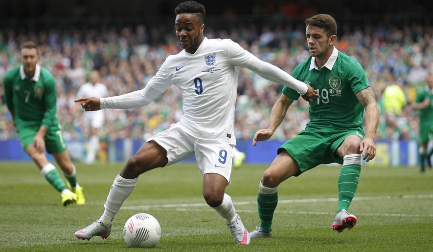 England's Raheem Sterling, left, wins the ball from Republic of Ireland's Robbie Brady during the international  soccer friendly match between Ireland and England, at the Aviva stadium, in Dublin, Ireland, Sunday, June 7, 2015.  (AP Photo/Peter Morrison)
