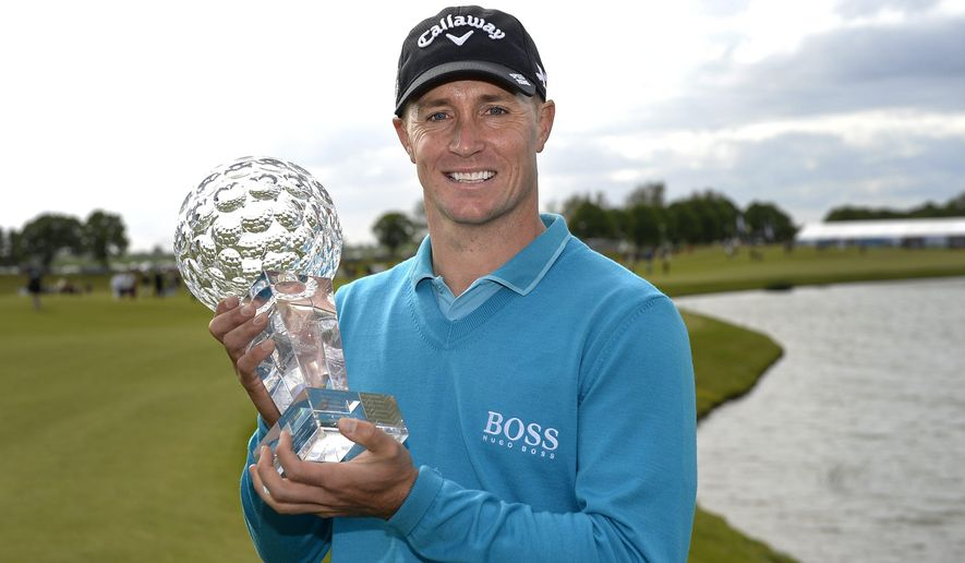 Sweden's Alex Noren poses with the trophy after winning the Nordea Masters at the PGA National golf course outside Malmo, Sweden, Sunday June 6, 2015. Noren won the Nordea Masters Sunday on eleven-under-par. (Anders Wiklund / TT via AP)  SWEDEN OUT