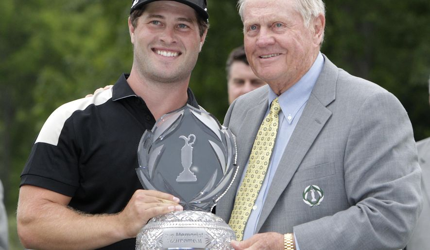 Jack Nicklaus, right, presents David Lingmerth, of Sweden, with the trophy after Lingmerth won the Memorial golf tournament in a three-hole playoff Sunday, June 7, 2015, in Dublin, Ohio. (AP Photo/Jay LaPrete)