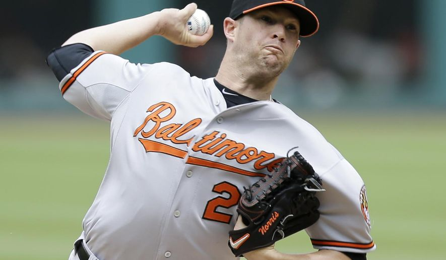 Baltimore Orioles starting pitcher Bud Norris delivers in the first inning of a baseball game against the Cleveland Indians, Sunday, June 7, 2015, in Cleveland. (AP Photo/Tony Dejak)