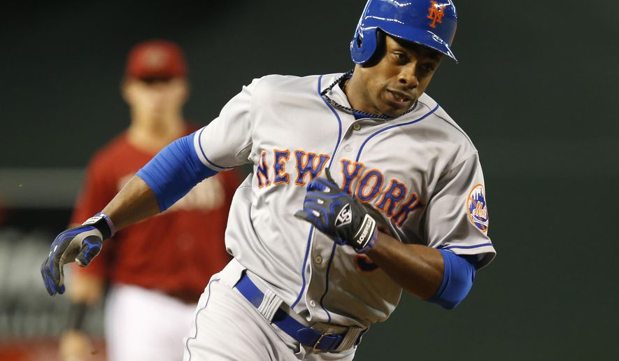 New York Mets Curtis Granderson runs the bases after hitting a solo home run in the first inning during a baseball game against the Arizona Diamondbacks, Sunday, June 7, 2015, in Phoenix. (AP Photo/Rick Scuteri)