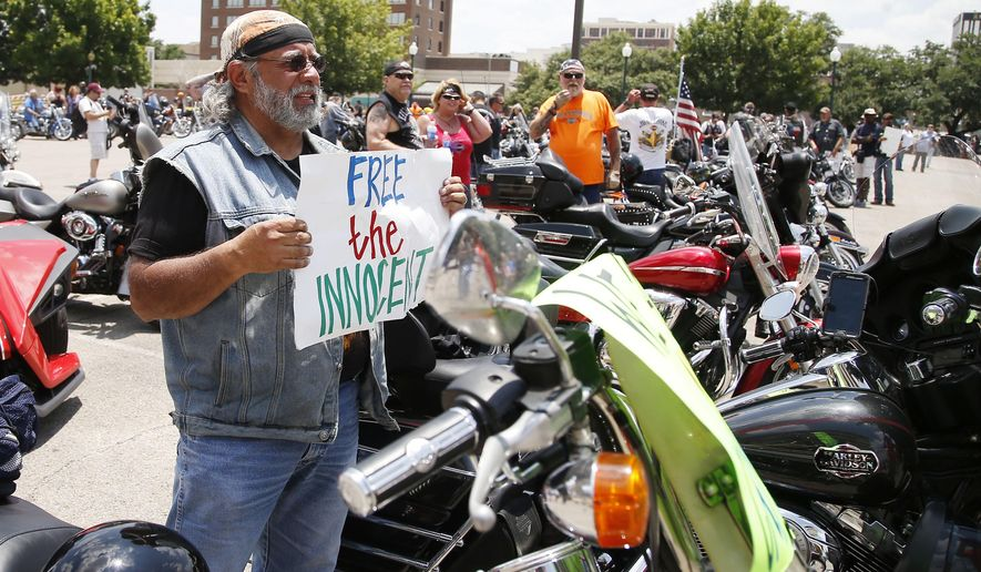 """Adam Valdez age 66, of Yoakum, Texas, arrives for the  """"All for 1"""" rally at the McLennan County courthouse parking lot in Waco, Texas, Sunday, June 7, 2015. Organizers, who have called the event a peaceful, silent protest, gathered in front of the courthouse to protest what they say is the violation of rights of many bikers who were arrested at Twin Peaks just for being at the scene of the crime. (Rod Aydelotte/Waco Tribune Herald via AP)"""
