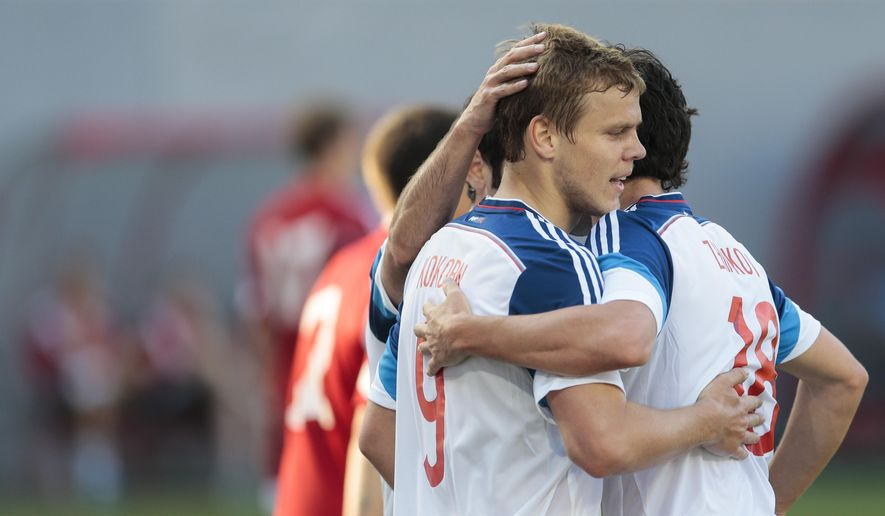 Russia's Alexander Kokorin celebrates with teammates after scoring the opening goal during the international friendly soccer match between Russia and Belarus at the Arena Khimki stadium, in Moscow, Russia, Sunday, June 7, 2015. (AP Photo/Ivan Sekretarev)