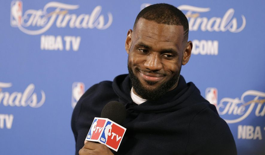 Cleveland Cavaliers forward LeBron James smiles during a news conference after Game 2 of basketball's NBA Finals Sunday, June 7, 2015, in Oakland, Calif. Cleveland won the game in 95-93 in overtime. (AP Photo/Ben Margot)