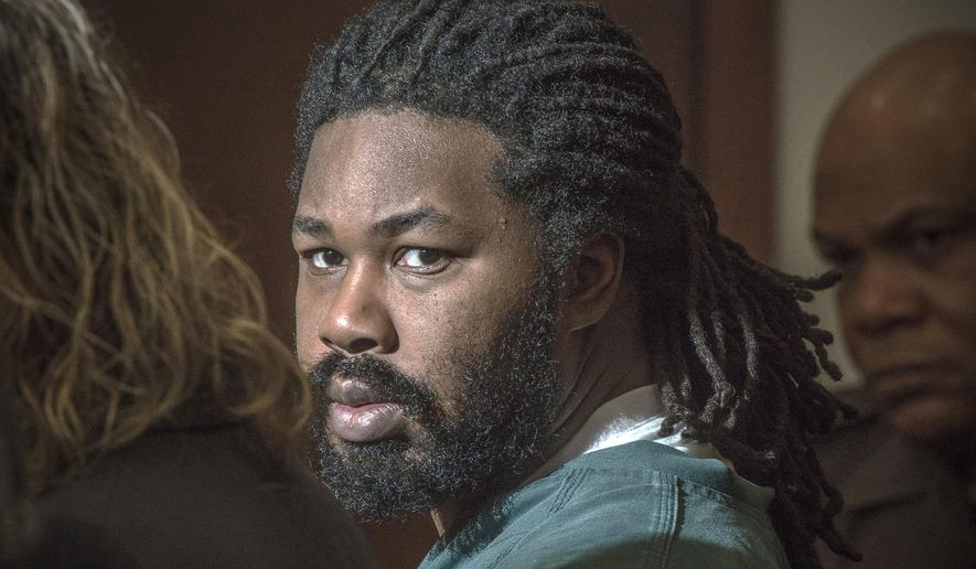 Jesse Matthew Jr. looks toward the gallery while appearing in court in Fairfax, Va., in this Nov. 14, 2014, file photo. (AP Photo/The Washington Post, Bill O'Leary, Pool, File)