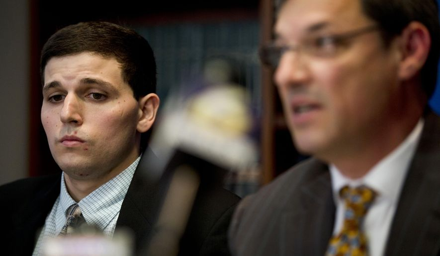 James Vivenzio, left, listens to his attorney Aaron J. Frewiald during news conference Monday, June 8, 2015, in Philadelphia. Vivenzio, a former student who blew the whistle on a Penn State fraternity's secret Facebook page featuring photos of naked women says the university ignored his complaints about sexual assault, hazing and drug use. Vivenzio of Great Falls, Virginia, says in a lawsuit Monday against the university and the suspended frat that he waited eight months for Penn State to take action before going to police in January.  (AP Photo/Matt Rourke)