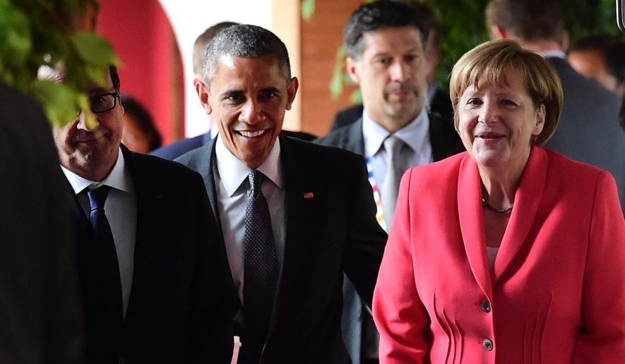 French President Francois Hollande, US President  Barack Obama and Germany's Chancellor Angela Merkel, from left, arrive for a working session of the  G-7 summit at Schloss Elmau hotel near Garmisch-Partenkirchen, southern Germany, Monday June 8, 2015. (John MacDougall/Pool Photo via AP)