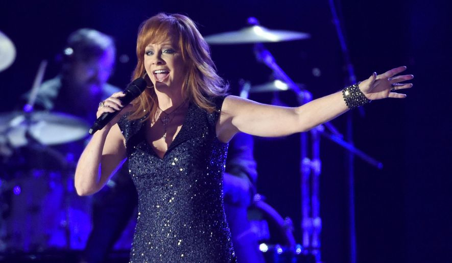 In this Sunday, April 19, 2015, file photo, Reba McEntire performs at the 50th annual Academy of Country Music Awards at AT&T Stadium in Arlington, Texas. McEntire will make a return to CMT Awards stage after a 10-year absence, performing at the awards show on Wednesday, June 10. (Photo by Chris Pizzello/Invision/AP, File)