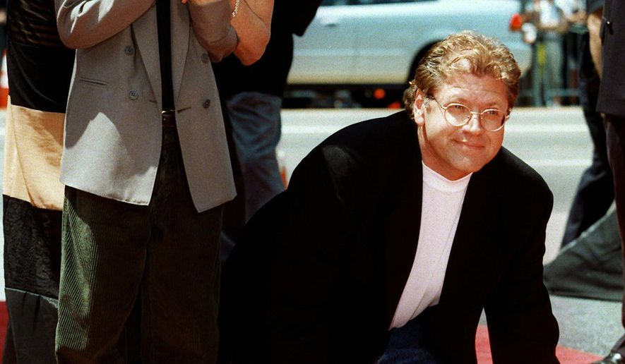 "FILE - In this July 8, 1997 file photo, film director Robert Zemeckis, poses with his wife, Mary Ellen, and his son, Alex, 11, next to a cement plaque which bears his signature, hands and footprints outside Mann's Chinese Theatre in the Hollywood section of Los Angeles. Actress Mary Ellen Trainor, who appeared in the ""Lethal Weapon"" films and ""The Goonies,"" has died. Lucasfilm President Kathleen Kennedy confirmed on Monday, June 8, 2015, that Trainor, a longtime friend, passed away at home in Montecito, California, on May 20. Trainor was married to Zemeckis for 20 years (they divorced in 2000). (AP Photo/Damian Dovarganes, File)"